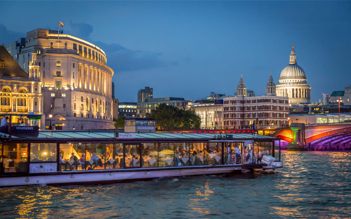 Dine by night on the river