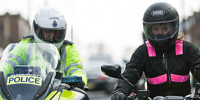 Police and motorcyclist supporting BikeSafe