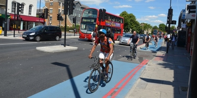 Image of commuter cycling on a Cycle Superhighway in London
