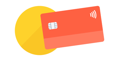 red contactless bank card over yellow card reader