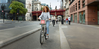 woman cycling on a cycle superhighway, on a Santander Cycle