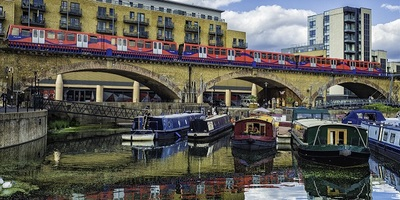 boats in the limehouse basic with the DLR train going over a bridge above