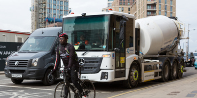 HGV with good direct vision stopped at junction with cyclist