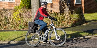 Man riding an e-bike in a residential area