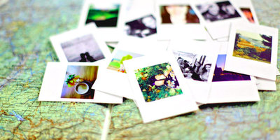 An assortment of photographs laid out on a paper map