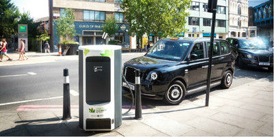 Electric taxi parked using a rapid charge point