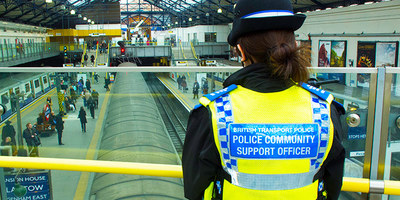 A Police Community Support Officer watches over a station concourse