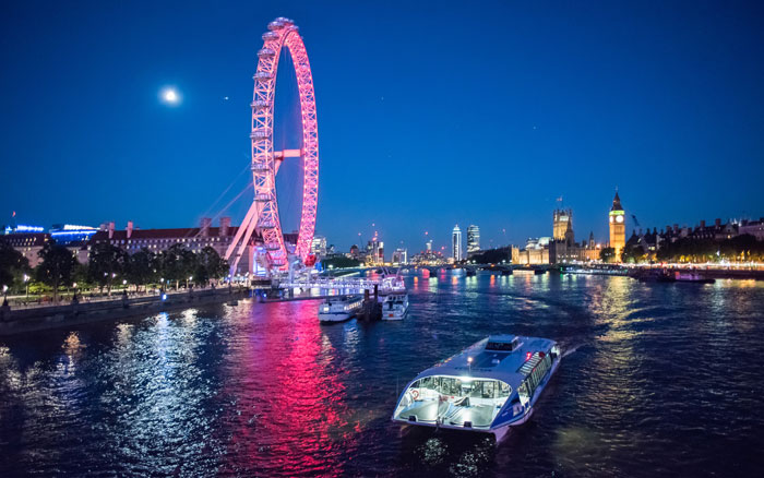 Enjoy the views of London from the river at night